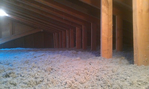 A fully restored attic with cellulose insulation