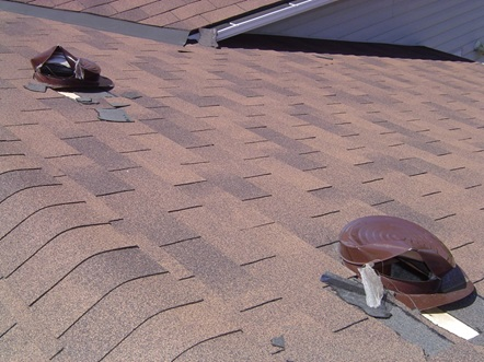 Roof vents damaged by raccoons to gain access to the attic