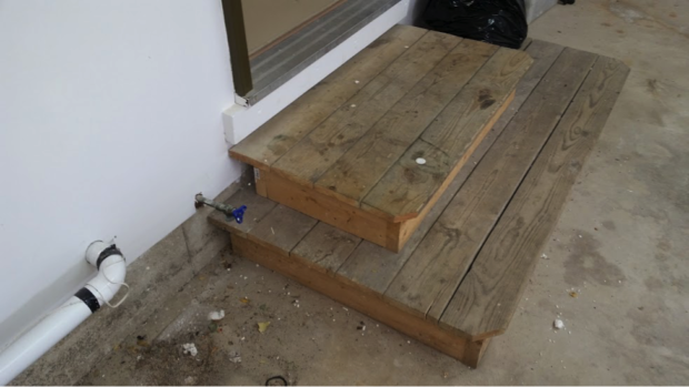 This staircase leading into a garage door was a perfect place for mice to store food
